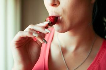 Tasting the strawberry