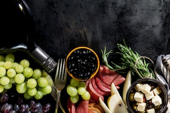 Tasty appetizing italian Mediterranean Food Ingredients Flat Lay on Dark Old Black Background Top View Copy Space Above