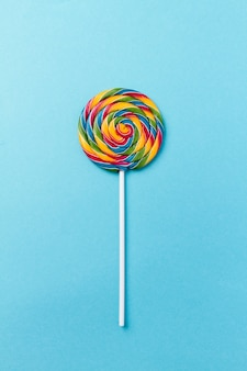 Tasty appetizing Party Accessory Sweet Swirl Candy Lollypop on Blue Background Top View