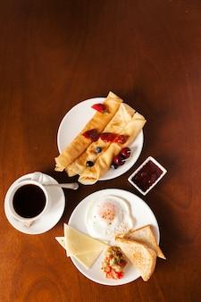 Tasty breakfast on table