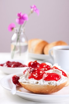 Tasty breakfast with bread and jam