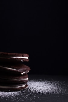 Tasty chocolate cookies with black background