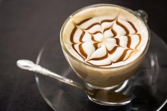 Tasty coffee with decorative star
