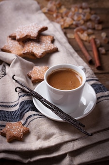 Tasty cup of coffee with baked cookies
