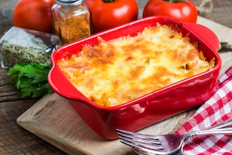 Tasty lasagna in a red container
