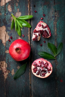 Tasty pomegranate with green leaves