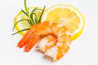 Tasty prawns on lemon slices