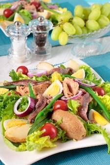 Tasty salad arranged on table