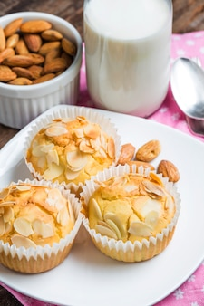Tasty sugar muffins with almond and walnuts