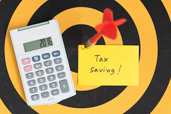 Tax saving note with dart arrow on bullseye