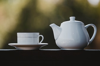 Teapot and a white cup