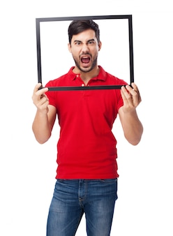 Teen shouting and holding a frame