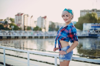 Teenage girl posing in a plaid short t-shirt