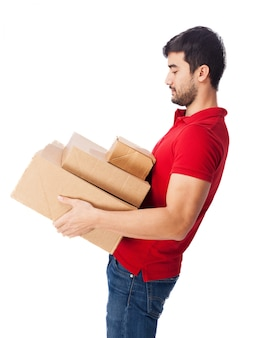 Teenager holding heavy boxes