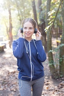 Teenager in sportswear walking through the park