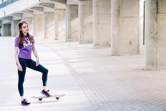 Teenager lands her foot on her skateboard