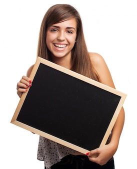 Teenager with a big smile posing with a chalkboard