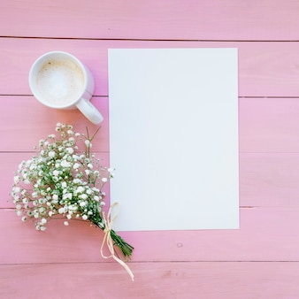 Template, coffee and bouquet with pink background
