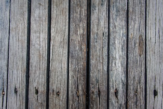 Texture of damaged planks with rusty nails