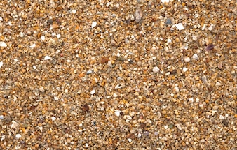 Textured of rough Pebble Stones on Samui beach.