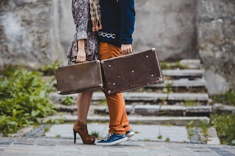 The boyfriend and girlfriend keeping suitcases