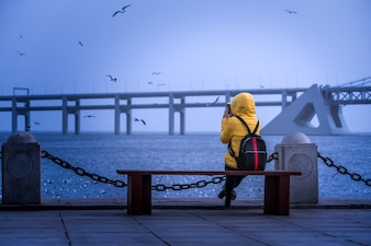 The girl watching the sea by the sea, early morning