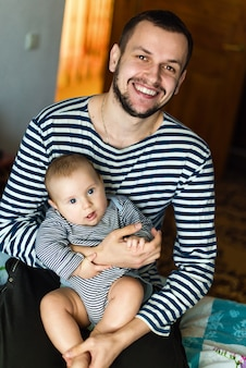 The man with child in striped sweaters