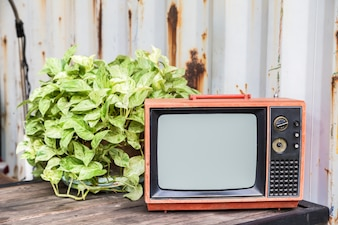 The old red television on wood table