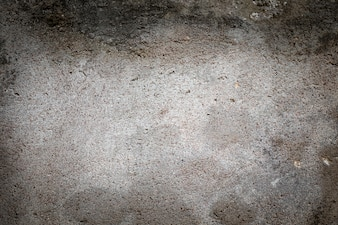 The raw grey concrete texture.The dark raw grey concrete texture.The dark raw grey concrete texture.