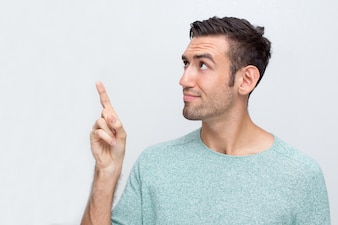 Thoughtful Attractive Man Pointing Upwards
