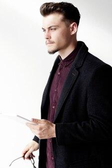 Thoughtful stylish man holding notes