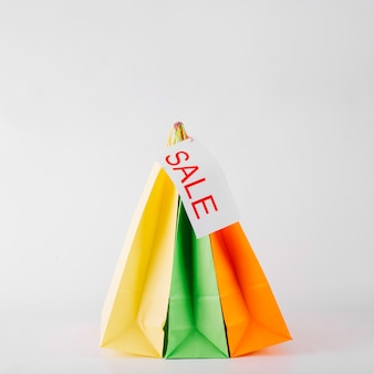 Three paper bags with sale label