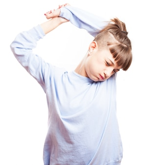 Tired young woman stretching her arms