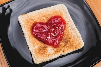 Toast with heart-shaped jam
