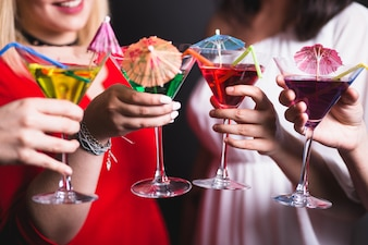 Toasting with cocktails at party