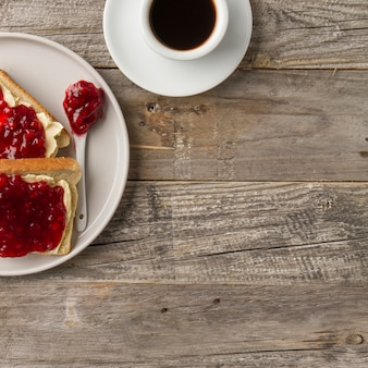 Toasts with jam and black coffee