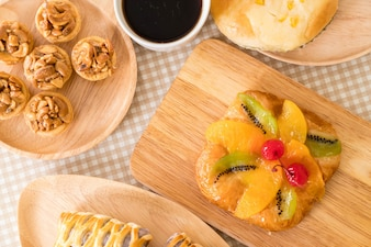 Toffee cake,bread with corn mayonaise, taro pies, danish mixed fruit with jam and coffee cup