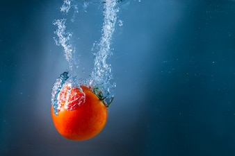 Tomato immersed in water