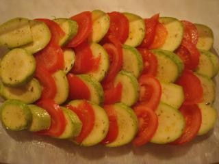 tomatoes and zucchini dish in preparatio