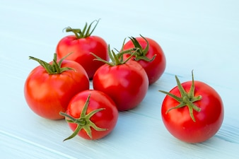 Tomatoes on a wooden turquoise background