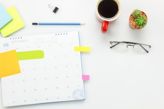 Top view accessories office desk concept.calendar,coffee,cactus,pencil on office desk.