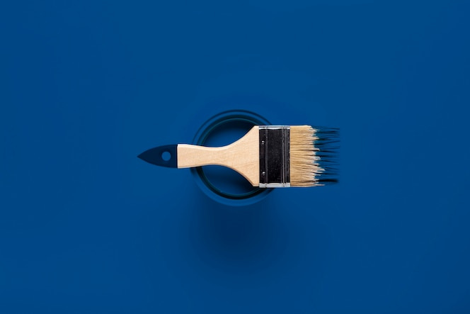 Top view brush on color of the year paint can