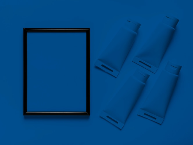 Top view empty frame with classic blue paint containers