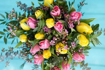 Top view of beautiful bouquet with colored flowers
