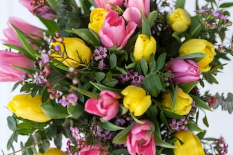 Top view of bouquet with pink and yellow tulips