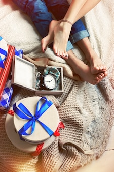 Top view of couple's feet with gifts
