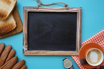 Top view of father's day composition with blank blackboard
