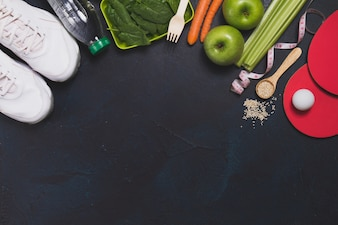 Top view of healthy food and sport accessories