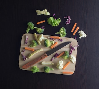 Top view of knife with vegetables