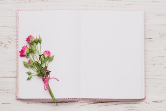 Top view of open book with cute flowers